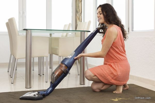 sitting woman with a vacuum cleaner